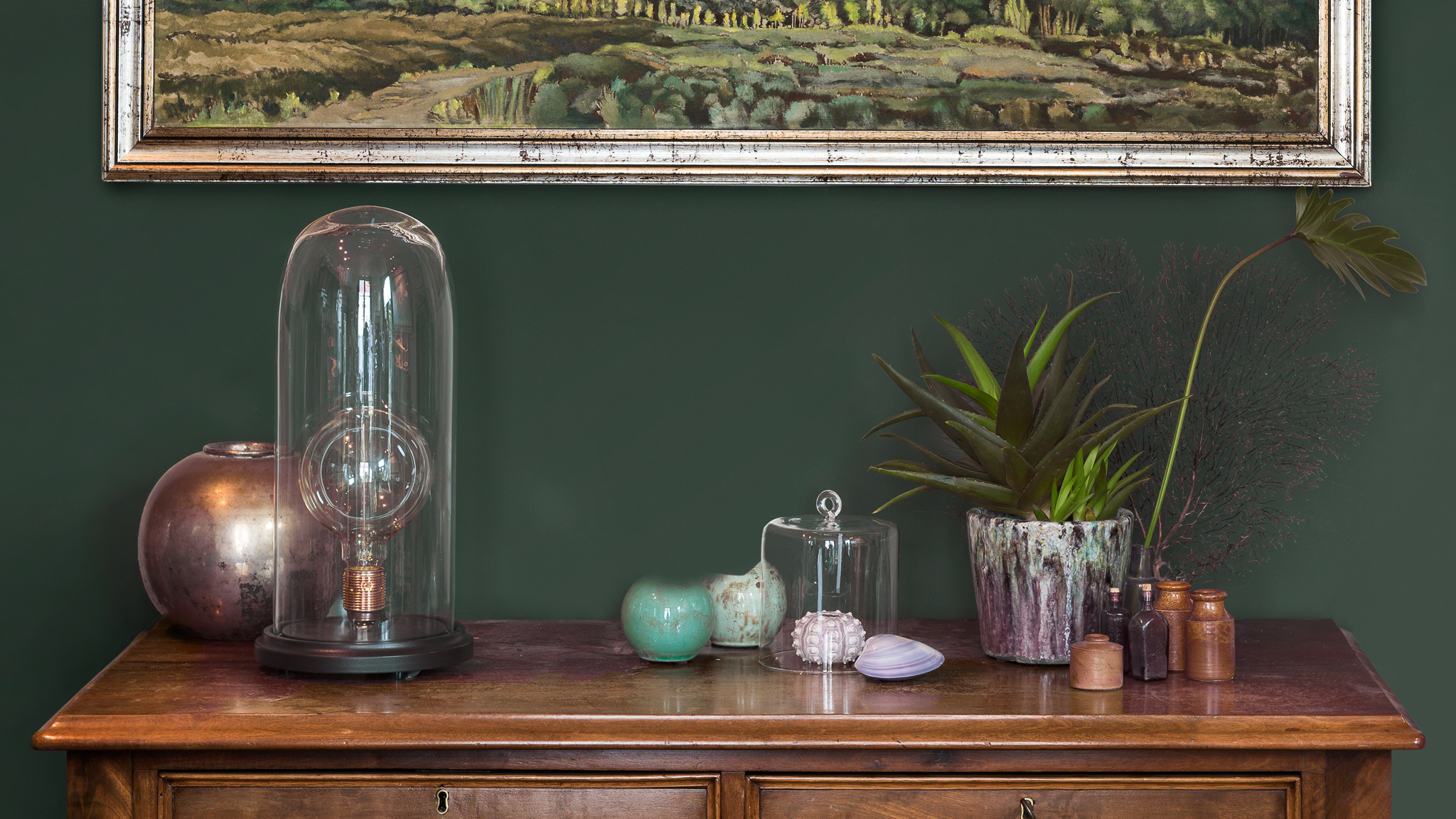 A deep, rich colour sets the tone for displaying antique objects.