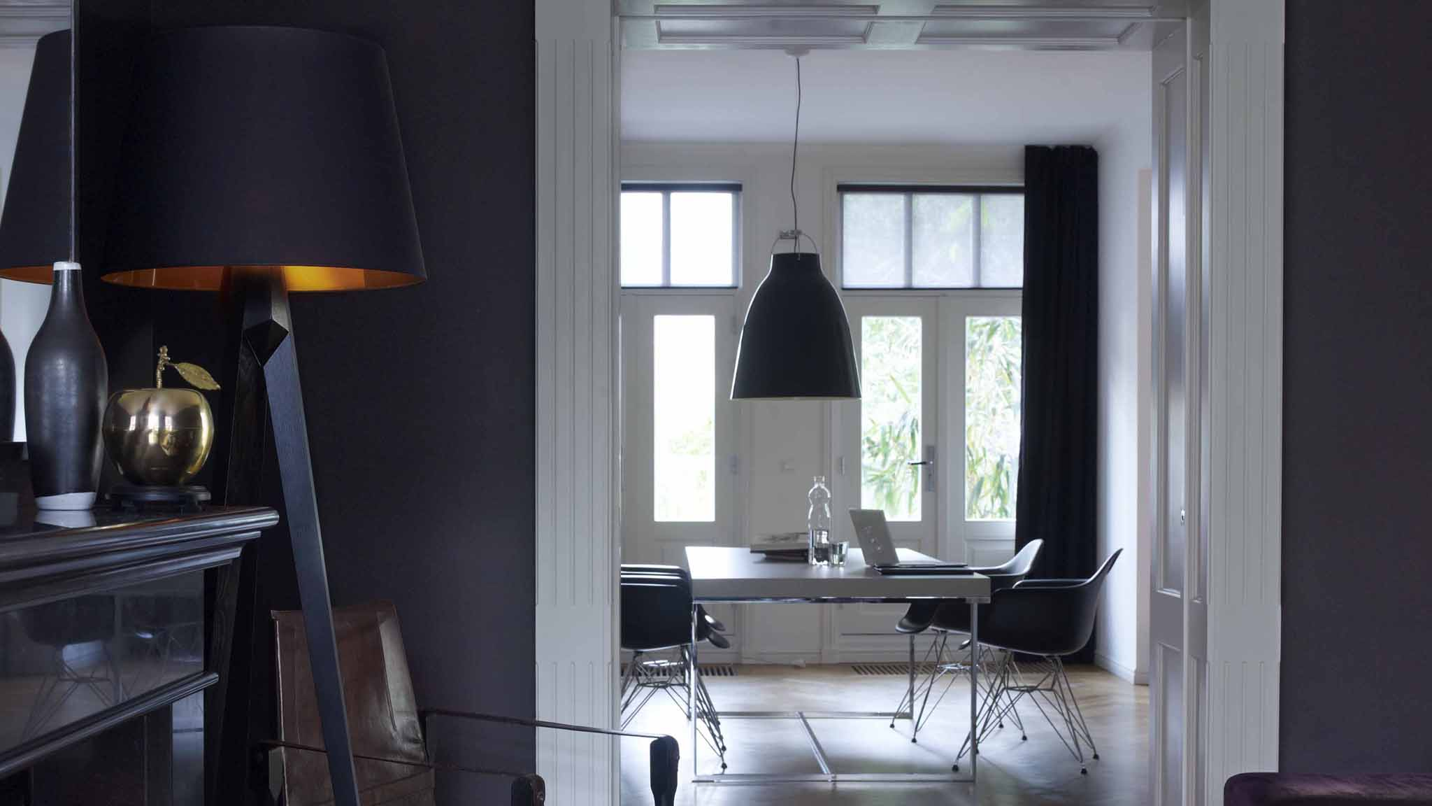 Some darker shades – such as deep, inky blues - are actually recessive, meaning they will add depth to your space and make a room feel larger