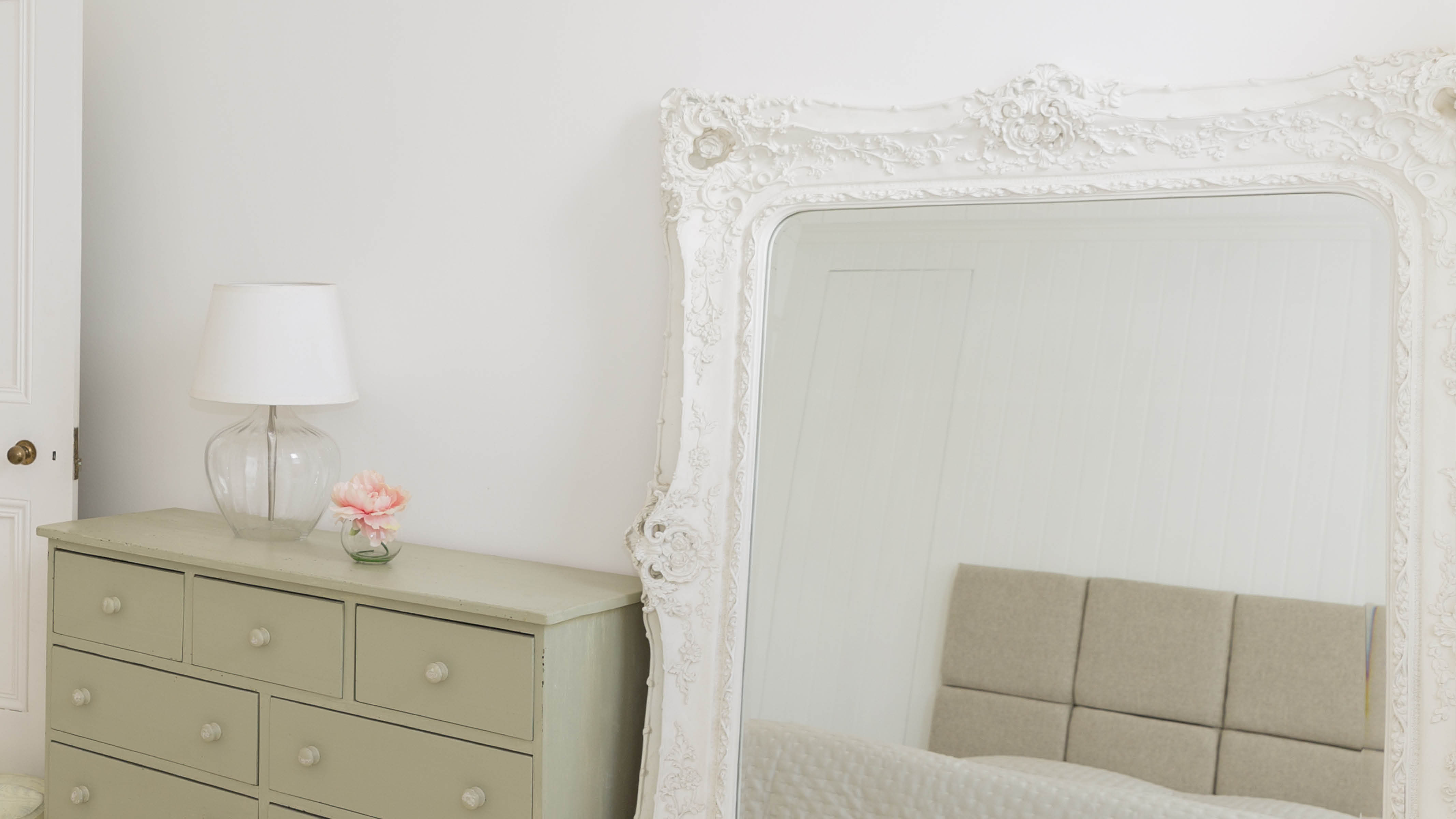 By leaning a large mirror against a wall you'll give the impression that the room is expanding and opening up at head height.