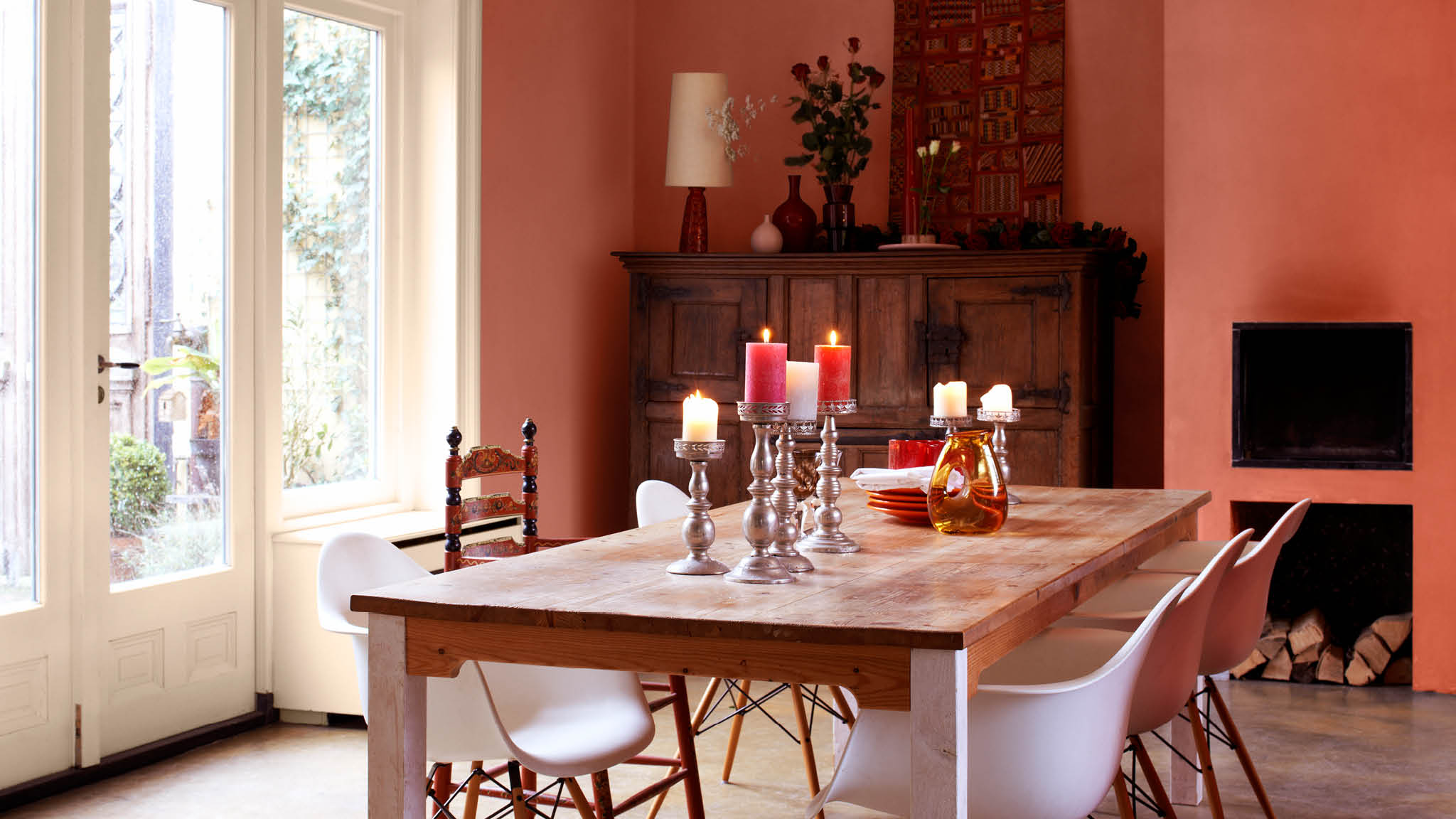 Vibrant coral with hints of orange is an uplifting and convivial shade that will energise your dining room without overpowering it.