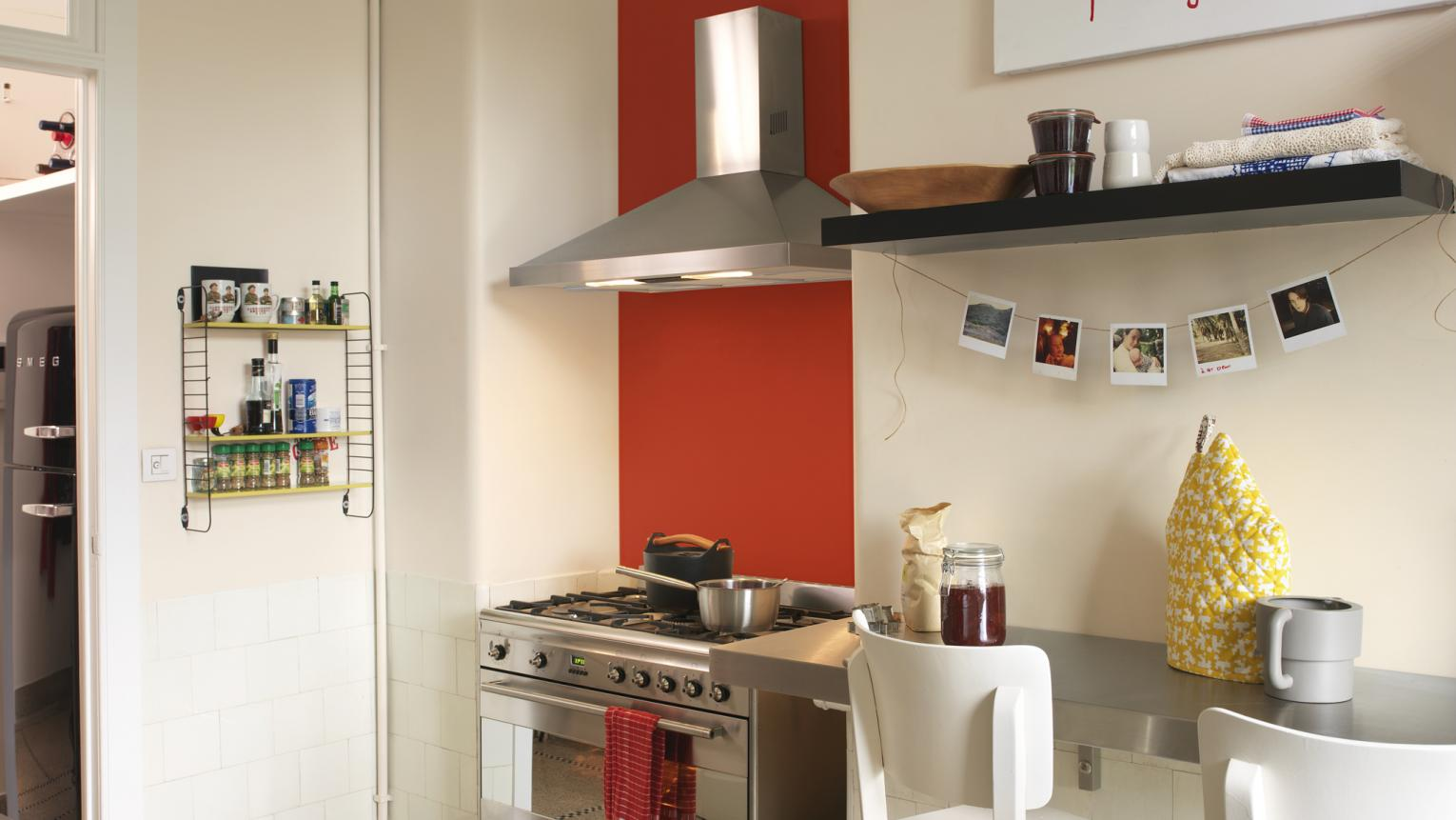 Use a bright accent colour to add energy to a plain kitchen.