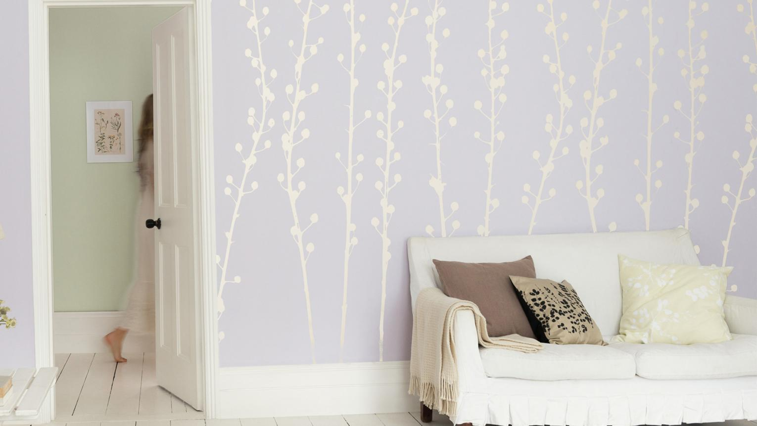 Looking for bedroom decorating ideas? Why not try using oversized floral wall stencils to create a bold botanical design.