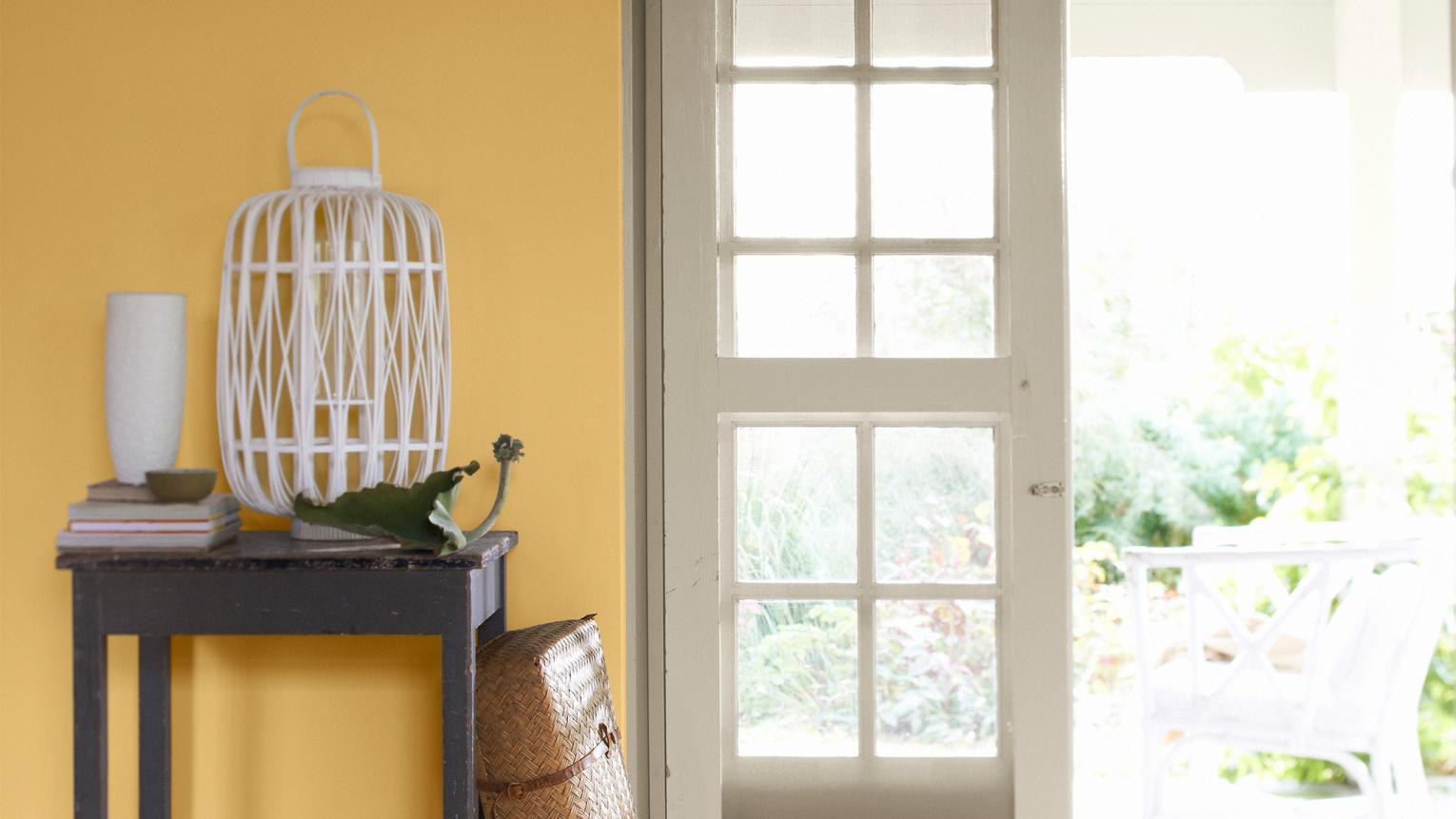 Infuse your hallway with warmth and energy with a sunny colour scheme of yellow and crisp white.