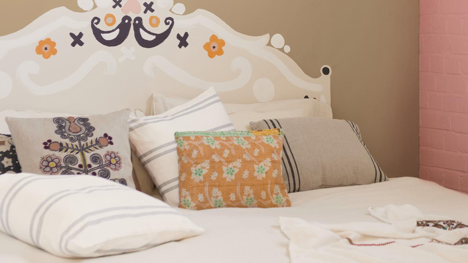 Create a fabulous focal point in your bedroom with a painted headboard. We show you how to create the look.