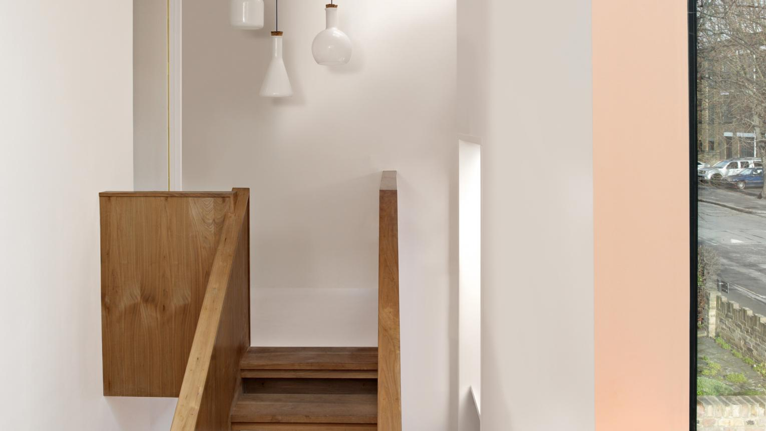 Add width to a tall, narrow space with a dark ceiling.