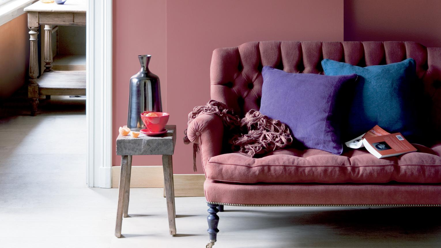 Accessorise a dusky pink living room with rich, jewel shades.