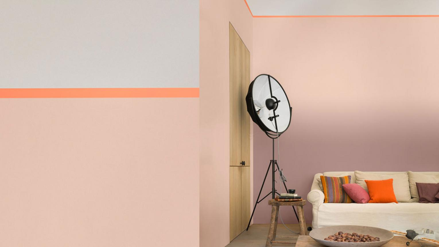To create a modern look, use salmon pink as a tinted neutral and contrast with a bright accent hue, such as zesty orange.