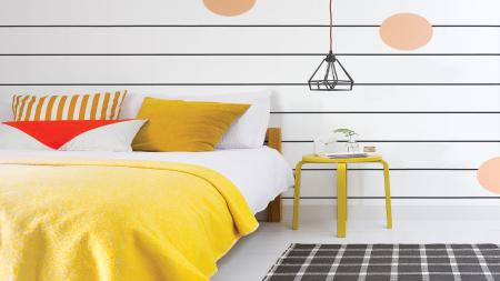 Paint horizontal stripes in your teenager's bedroom for a stylish new look